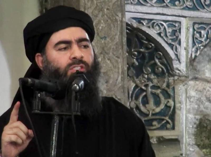 FILE - This file image made from video posted on a militant website July 5, 2014, purports to show the leader of the Islamic State group, Abu Bakr al-Baghdadi, delivering a sermon at a mosque in Iraq during his first public appearance. The Islamic State group released on Thursday, Sept. 28, 2017 a purported audio recording from top leader al-Baghdadi.  (Militant video via AP, File)