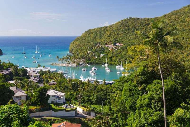 View over the village and harbour to the Caribbean Sea, Marigot Bay, Castries, St. Lucia, Windward Islands, Lesser Antilles, West Indies, Caribbean, Central America. Getty Images