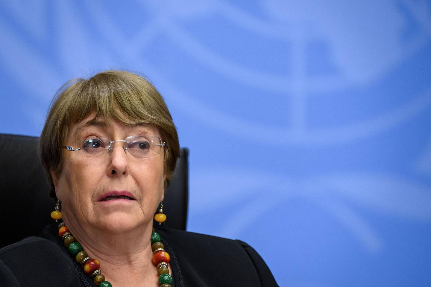 (FILES) In this file photograph taken on December 9, 2020, UN High Commissioner for Human Rights Michelle Bachelet looks on as she attends a press conference in Geneva. Leading human rights organizations and relatives of victims urged the United Nations on May 10, 2021 to create a commission to conduct an independent inquiry into police violence against African Americans in the United States. Human Rights Watch, Amnesty International and the American Civil Liberties Union were among the dozens of groups that made the request in a letter to UN High Commissioner for Human Rights Michelle Bachelet.   / AFP / Fabrice COFFRINI
