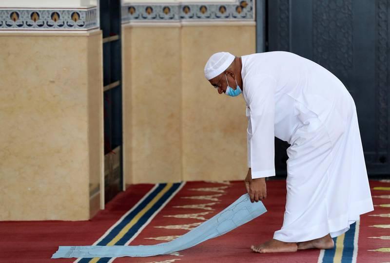 Dubai, United Arab Emirates - December 03, 2020: Lays down a disposable prayer mat at Al Farooq Omar Bin Al Khattab Mosque for midday prayers. Thursday, December 3rd, 2020 in Dubai. Chris Whiteoak / The National
