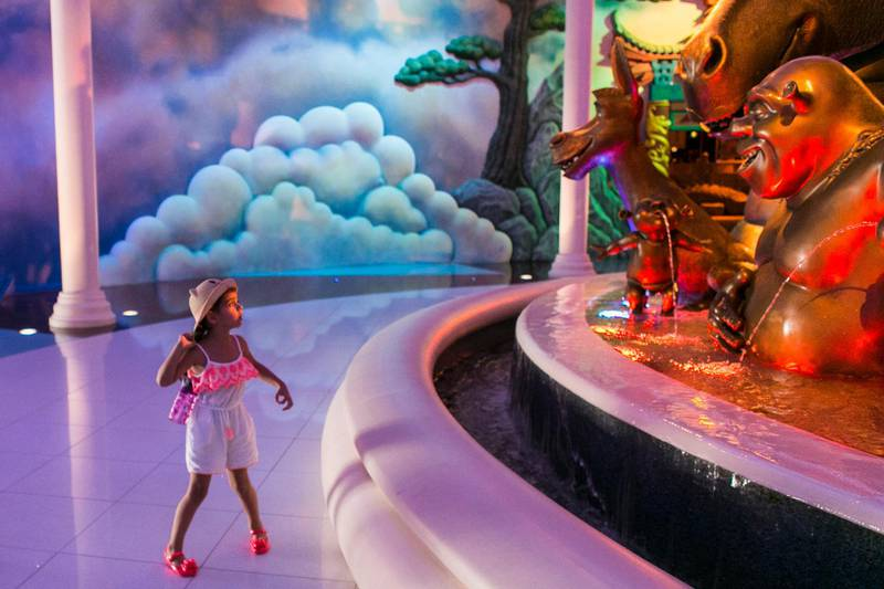 DUBAI, UNITED ARAB EMIRATES - JULY 18: The National's reporter, Hala Khalaf, took her daughter, Alana, seen pictured here by the fountain at the new Dreamworks Animation Zone at Motiongate, Dubai Parks & Resorts.(Photo by Reem Mohammed/The National)Reporter: Hala KhalafSection: AC