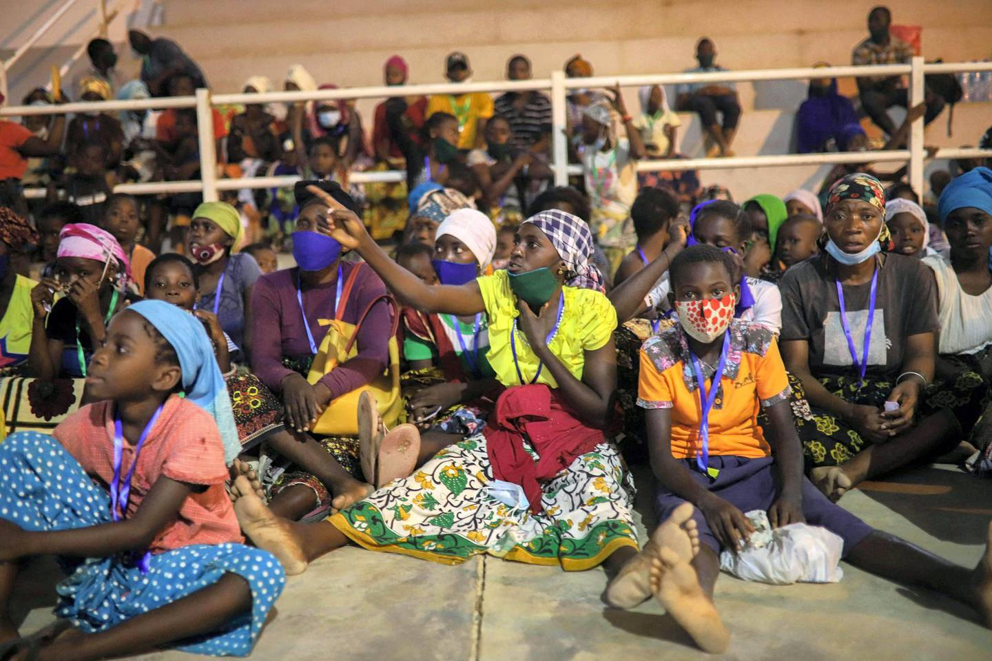 TOPSHOT - Internally displaced people (IDP) from Palma gather in the Pemba Sports center to receive humanitarian aid in Pemba on April 2, 2021. They people were evacuated from the coasts of Palma after armed insurgents attacked the city on March 24, 2021. / AFP / Alfredo Zuniga