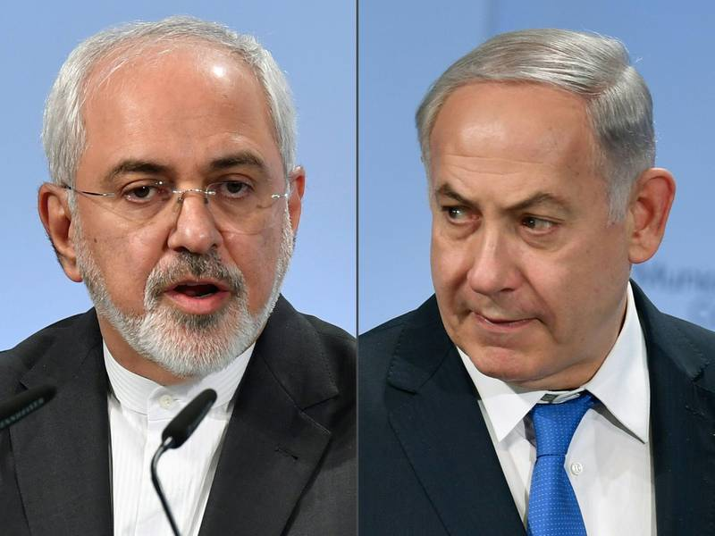 """(COMBO) This combination of pictures created on February 18, 2018 shows Iranian Foreign Minister Mohammad Javad Zarif (L) and Israeli Prime Minister Benjamin Netanyahu (R) as they attend the Munich Security Conference on February 18, 2018 in Munich, southern Germany. Netanyahu warned Tehran over aggressions by what he called Iran and its """"proxies"""" in Syria, while showing what he claimed was a piece of an Iranian drone shot down in Israeli airspace. / AFP PHOTO / Thomas KIENZLE"""