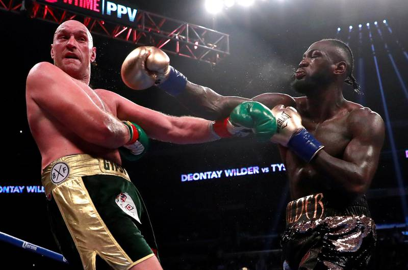 FILE PHOTO: Boxing - Deontay Wilder v Tyson Fury - WBC World Heavyweight Title - Staples Centre, Los Angeles, United States - December 1, 2018  Deontay Wilder in action against Tyson Fury  Action Images via Reuters/Andrew Couldridge/File Photo