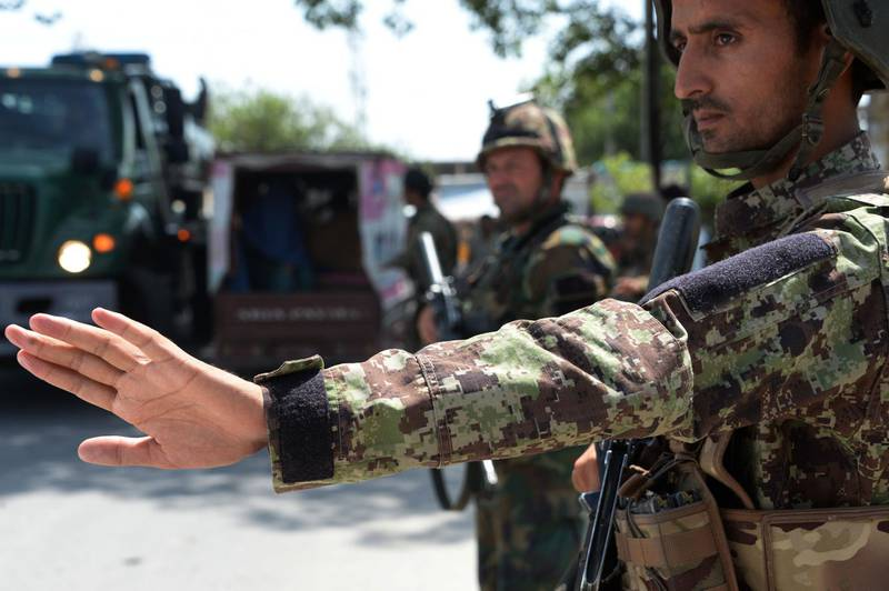 Afghan National Army (ANA) soldiers search vehicles at a checkpoint in the city of Jalalabad on August 1, 2018. Afghanistan ramped up security in Jalalabad on August 1, a day after militants stormed a government office killing 15 people, including foreign aid agency workers, in the latest assault in the Islamic State group's eastern stronghold. / AFP PHOTO / NOORULLAH SHIRZADA
