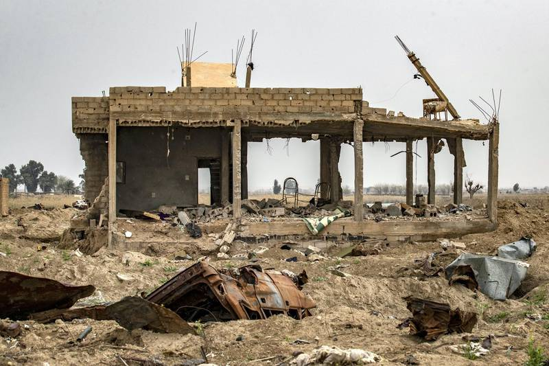The house of local farmer Hamad al-Ibrahim is seen destroyed in the eastern Syrian village of Baghouz on March 13, 2020, a year after the fall of the Islamic State's (IS) caliphate. - A year after the last black flag of the Islamic State group was lowered in the Syrian village of Baghouz, traces of the jihadist group are still all around this small and remote village near the Iraqi border, where Kurdish fighters and the US-led coalition declared the IS proto-state defeated in March 2019 after a blistering months-long assault. (Photo by DELIL SOULEIMAN / AFP)