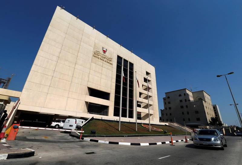 FILE PHOTO: A car passes in front of the Central Bank of Bahrain in Manama October 27, 2013.   REUTERS/Hamad I Mohammed/File photo