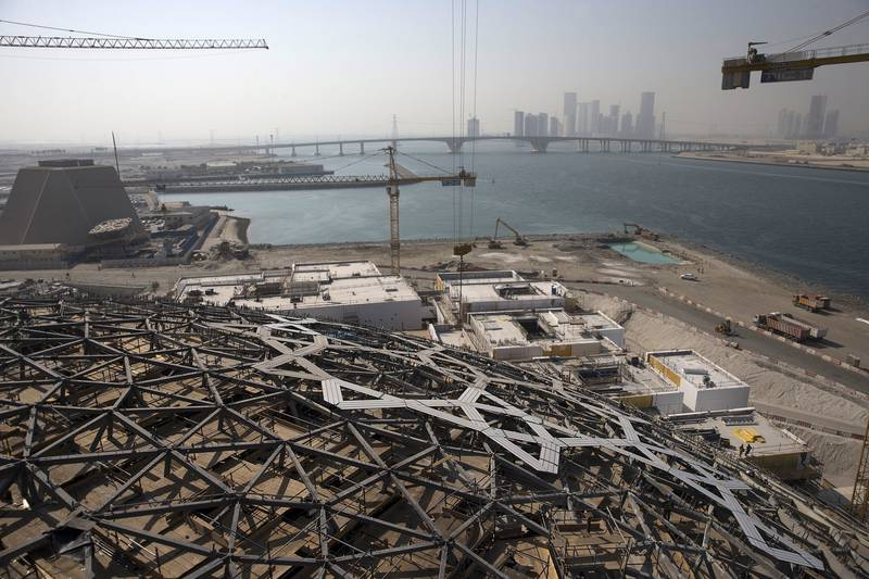 ABU DHABI, UNITED ARAB EMIRATES, Sep. 22, 2014:  A view of the of the Louvre Abu Dhabi (LAD) dome and the beginning stages of cladding work, as workers prepare to lift the very last super-sized element (SSE), number 85, into its place on Monday morning, Sep. 22, 2014, at the construction site on Saadiyat Island in Abu Dhabi. With just over a year left for the completion of LAD, Middle East outpost of the famed gallery in Paris, work will be shifting from the construction of the large structures to further and further refining the future gallery into its final polished state.  (Silvia Razgova / The National)Usage: undated, RESTRICTEDSection: NAReporter: James Langton