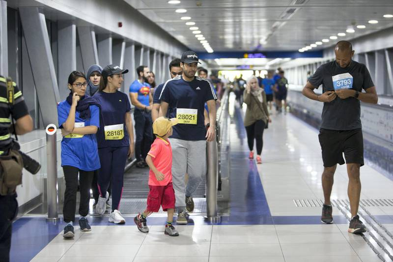 Dubai, United Arab Emirates - Participants of the run arriving at the metro station at the Dubai 30x30 Run at Sheikh Zayed Road.  Leslie Pableo for The National