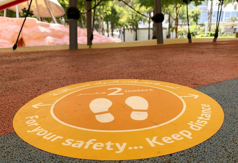 DUBAI, UNITED ARAB EMIRATES , October 10 – 2020 :- 2 meter distance sticker pasted on the floor at the kids play area at the Zabeel park in Dubai. Stickers about Covid safety measures pasted all over the park for the visitors. (Pawan Singh / The National) For News/Stock/Online.