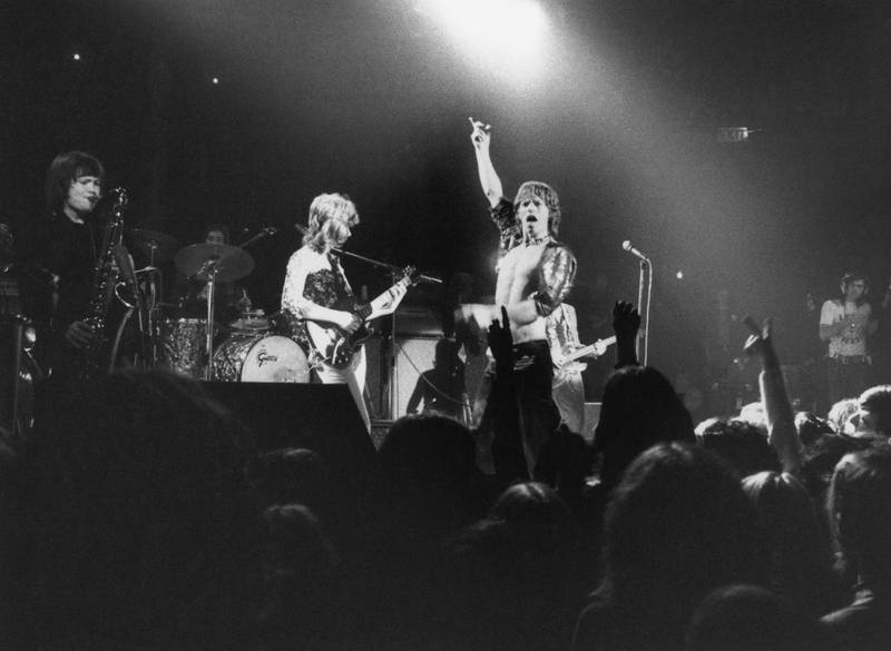 The Rolling Stones perform at the Roundhouse, London, 14th March 1971. The band features Bobby Keys on saxophone, left, and Mick Taylor on guitar, centre. (Photo by Evening Standard/Hulton Archive/Getty Images)