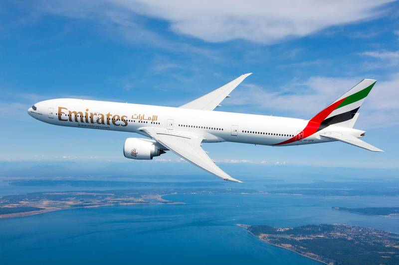 Emirates Boeing 777-300ER photographed on August 17, 2015 from Wolfe Air Aviation's Lear 25B.