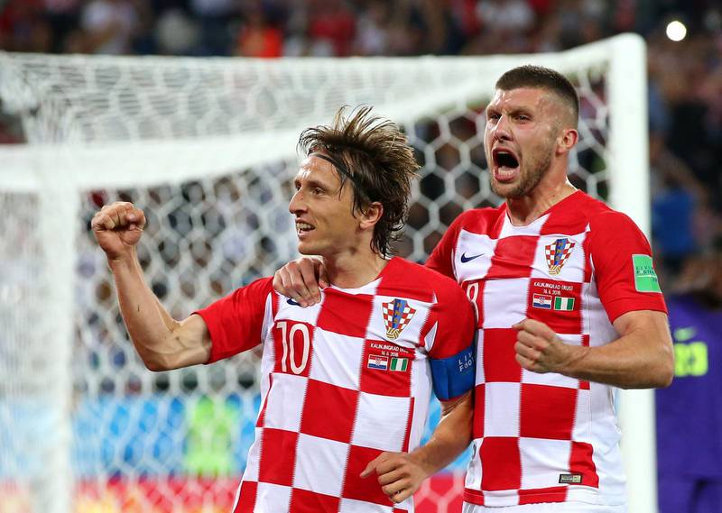 KALININGRAD, RUSSIA - JUNE 16:  Luka Modric of Croatia celebrates with Ante Rebic after scoring from a penalty for his sides second goal during the 2018 FIFA World Cup Russia group D match between Croatia and Nigeria at Kaliningrad Stadium on June 16, 2018 in Kaliningrad, Russia.  (Photo by Alex Livesey/Getty Images)