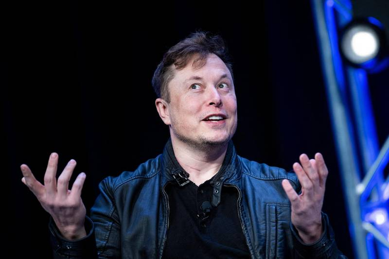 """(FILES) In this file photo Elon Musk, speaks during the Satellite 2020 at the Washington Convention Center on March 9, 2020, in Washington, DC. Tesla has abandoned a plan for an ultra-deluxe Plaid+ version of its Model S vehicle, according to founder Elon Musk. Musk said in a tweet on June 6, 2021 that the juiced-up Plaid is """"just so good,"""" that there is no need to go further with the Plaid+ model.  / AFP / Brendan Smialowski"""