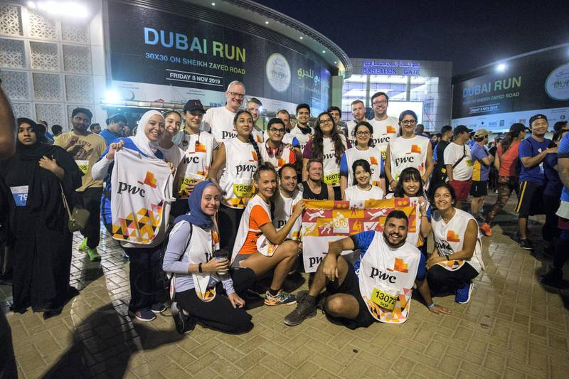 Dubai, United Arab Emirates - Participants doing group photo at the Dubai 30x30 Run at Sheikh Zayed Road.  Leslie Pableo for The National