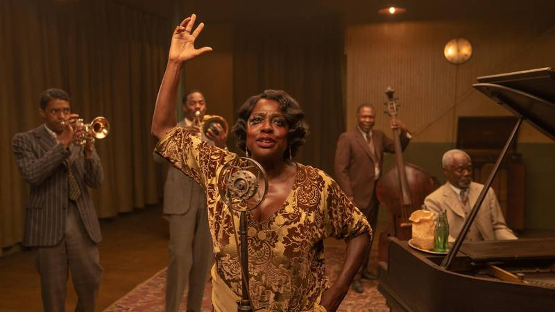 """This image released by Netflix shows Chadwick Boseman, from left, Colman Domingo, Viola Davis, Michael Potts and Glynn Turman in """"Ma Rainey's Black Bottom."""" Davis was nominated for a Golden Globe for best actress in a motion picture drama on Wednesday, Feb. 3, 2021 for her role in the film. (David Lee/Netflix via AP)"""