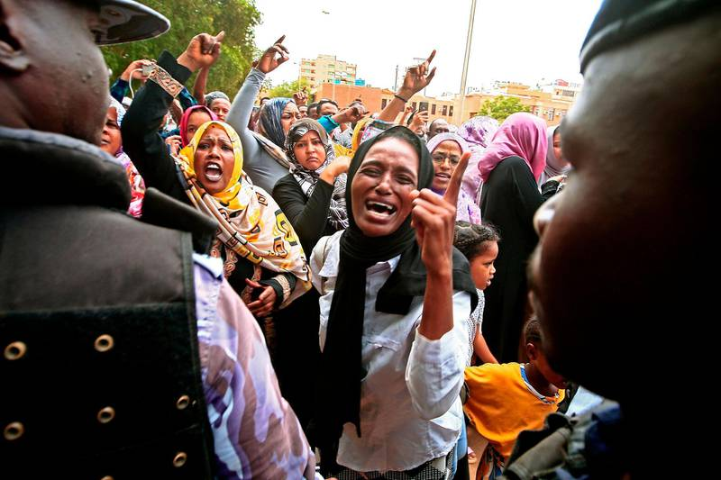Demonstrators chant slogans as they protest outside the courthouse where the trial is held for Sudan's ousted president Omar al-Bashir along with 27 co-accused, over the 1989 military coup that brought Bashir to power, in the capital Khartoum on September 15, 2020.  / AFP / Ebrahim HAMID