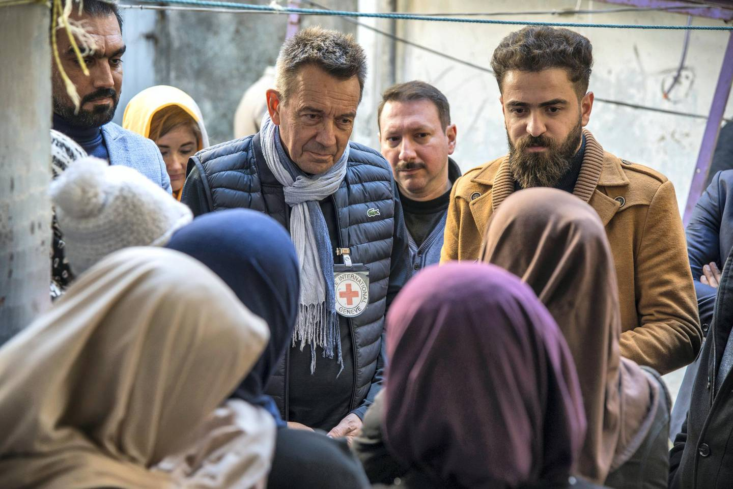 Mosul. The ICRC president, Peter Maurer, is listening to what families have experienced during the war and their suffering.