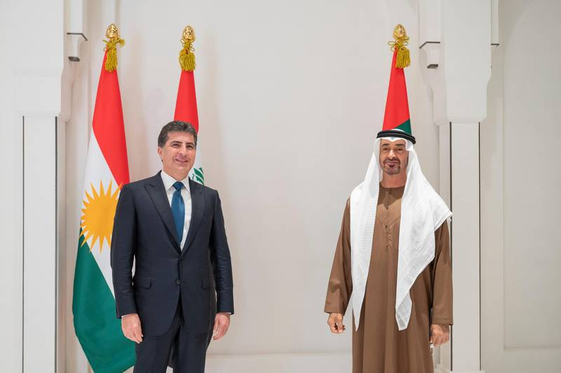 ABU DHABI, UNITED ARAB EMIRATES - June 12, 2021: HH Sheikh Mohamed bin Zayed Al Nahyan, Crown Prince of Abu Dhabi and Deputy Supreme Commander of the UAE Armed Forces (R) stands for a photograph with HE Nechirvan Barzani, President of the Kurdistan Region in Iraq (L), prior a meeting at Al Shati Palace.  ( Mohamed Al Hammadi / Ministry of Presidential Affairs ) ---