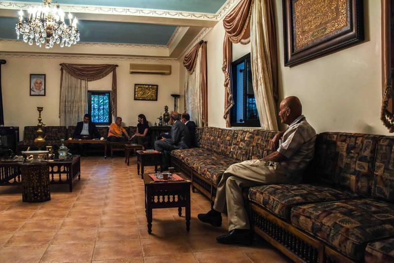 Bouday, Lebanon, 10 October 2020. Members of the Chamas clan linger in the meeting room of Sheikh abbas Chamas following a gathering called to discuss regional response to the killing of family member, Mohammad Chamas by a member of the Jaafar family 4 October 2020. Elizabeth Fitt for The National