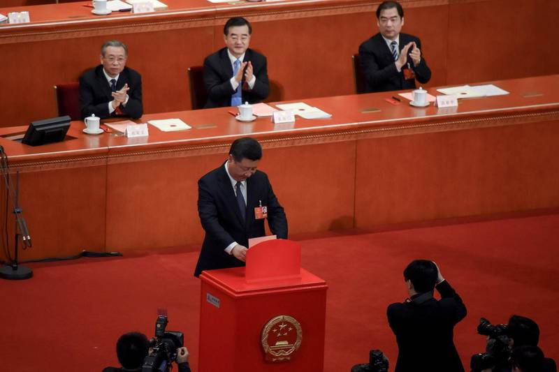 BEIJING, CHINA - MARCH 11:  Chinese President Xi Jinping votes during the third plenary session of the first session of the 13th National People's Congress (NPC) at The Great Hall of People on March 11, 2018 in Beijing, China. China's parliament voted on March 11 to abolish presidential term limits, clearing the path for President Xi Jinping to rule for life.  (Photo by Etienne Oliveau/Getty Images)