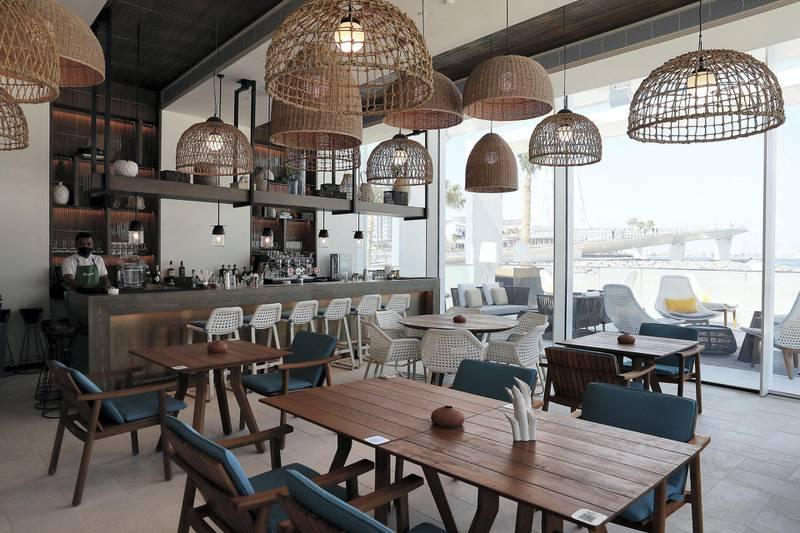 DUBAI, UNITED ARAB EMIRATES , December 24 – 2020 :-  View of the  beach grill restaurant at the Address Beach Resort near Jumeirah Beach Residences in Dubai. ( Pawan Singh / The National ) For Lifestyle. Story by Janice