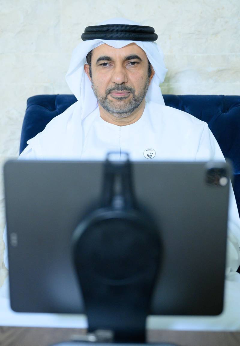 """ABU DHABI, UNITED ARAB EMIRATES - May 19, 2020: HE Matar Al Nuaimi, Director General of the Abu Dhabi Public Health Centre, participates in an online lecture by HE Obaid Rashid Al Shamsi, Director-General of the National Emergency Crisis and Disaster Management Authority, titled """"Honoring Our Traditions, Valuing Our Safety"""". The lecture was broadcast on Al Emarat Channel as part of the Ramadan lecture series of Majlis Mohamed bin Zayed.  ( Saeed Al Neyadi / Ministry of Presidential Affairs ) ---"""