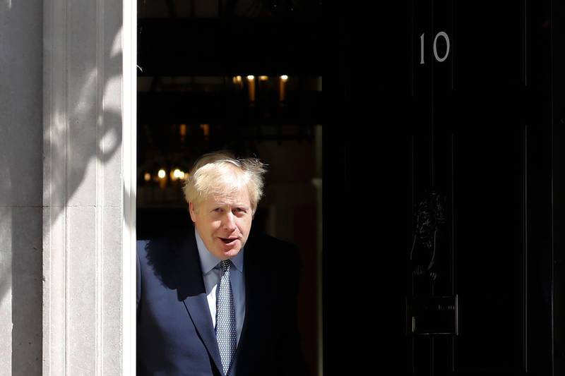 TOPSHOT - Britain's Prime Minister Boris Johnson steps out of 10 Downing Street in central London on August 6, 2019 to greet Estonian Prime Minister Juri Ratas (unseen). / AFP / Tolga AKMEN