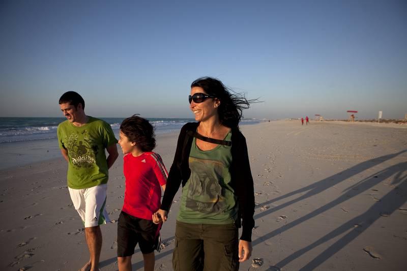 Abu Dhabi, United Arab Emirates, March 12, 2013:  People enjoy a breezy, warm evening on a new public beach, the Bake on Tuesday, March 12, 2013, on Saadiyat Island, Abu Dhabi.  Silvia Razgova / The National