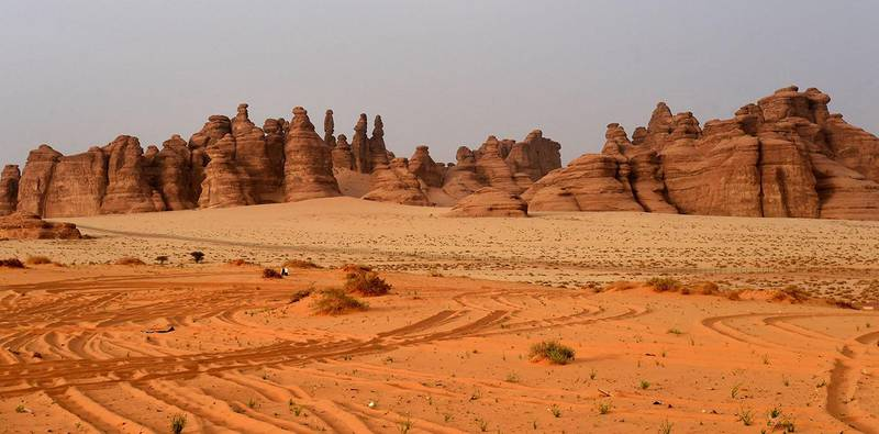 A picture taken on March 31, 2018 shows rose-coloured sandstone in Madain Saleh, a UNESCO World Heritage site, near Saudi Arabia's northwestern town of al-Ula. - Al-Ula, an area rich in archaeological remnants, is seen as a jewel in the crown of future Saudi attractions as the austere kingdom prepares to issue tourist visas for the first time -- opening up one of the last frontiers of global tourism. Saudi Crown Prince Mohammed bin Salman is set to sign a landmark agreement with Paris on April 10, 2018 for the touristic and cultural development of the northwestern site, once a crossroads of ancient civilisations. (Photo by FAYEZ NURELDINE / AFP)