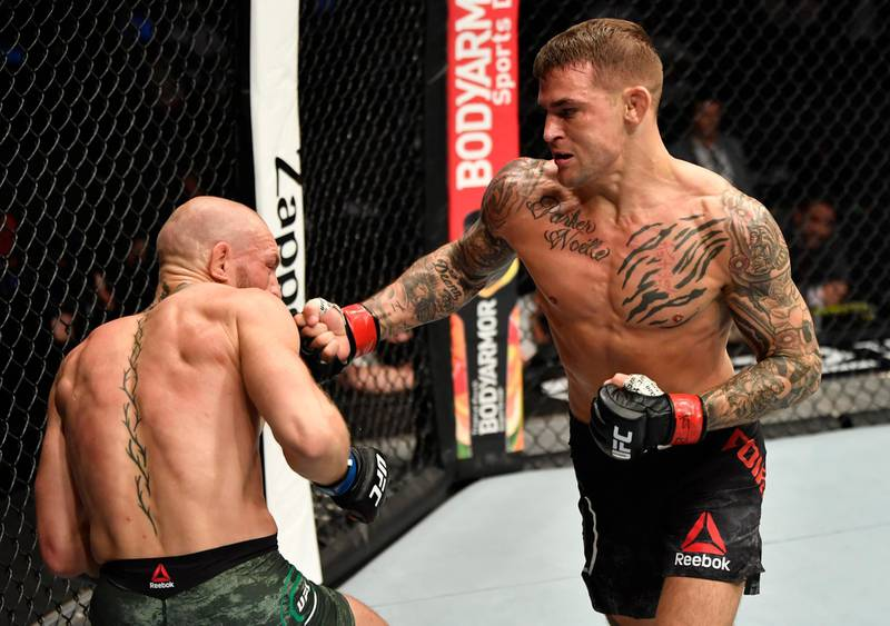 ABU DHABI, UNITED ARAB EMIRATES - JANUARY 23: (R-L) Dustin Poirier punches Conor McGregor of Ireland in a lightweight fight during the UFC 257 event inside Etihad Arena on UFC Fight Island on January 23, 2021 in Abu Dhabi, United Arab Emirates. (Photo by Jeff Bottari/Zuffa LLC)