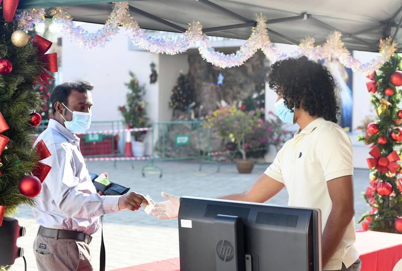 Abu Dhabi, United Arab Emirates - Registration checks for Christmas mass at St. JosephÕs Cathedral, in Mushrif. Khushnum Bhandari for The National