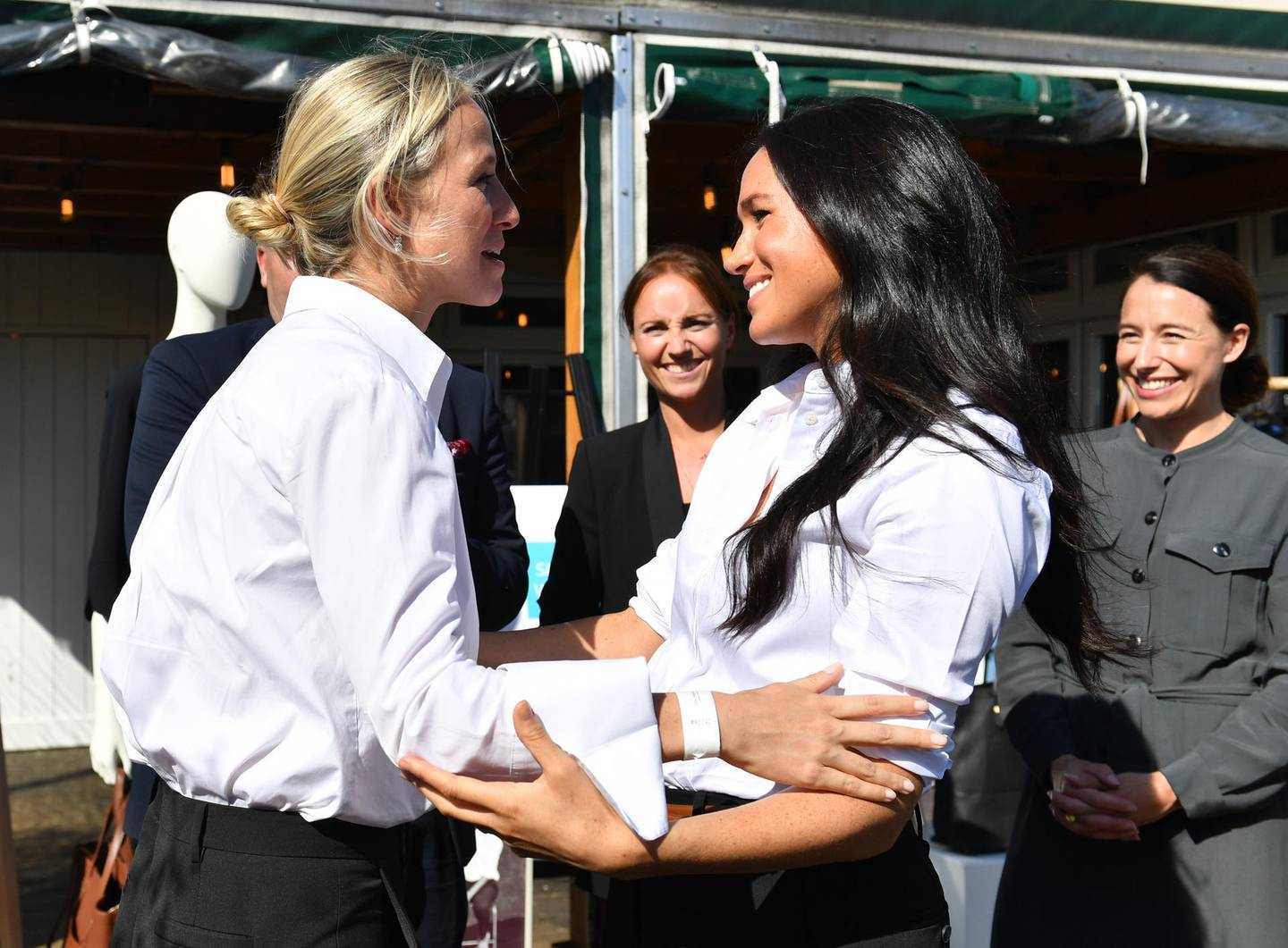 LONDON, ENGLAND - SEPTEMBER 12: Meghan, Duchess of Sussex embraces designer Misha Nonoo as she launches the Smart Works capsule collection on September 12, 2019 in London, England. Created in September 2013 Smart Works exists to help unemployed women regain the confidence they need to succeed at job interviews and return to employment. (Photo by Mark Large - WPA Pool/Getty Images)