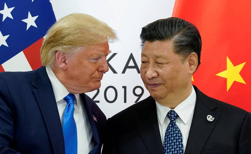 FILE PHOTO: U.S. President Donald Trump meets with China's President Xi Jinping at the start of their bilateral meeting at the G20 leaders summit in Osaka, Japan, June 29, 2019. REUTERS/Kevin Lamarque - RC1E7DB7CCD0/File Photo