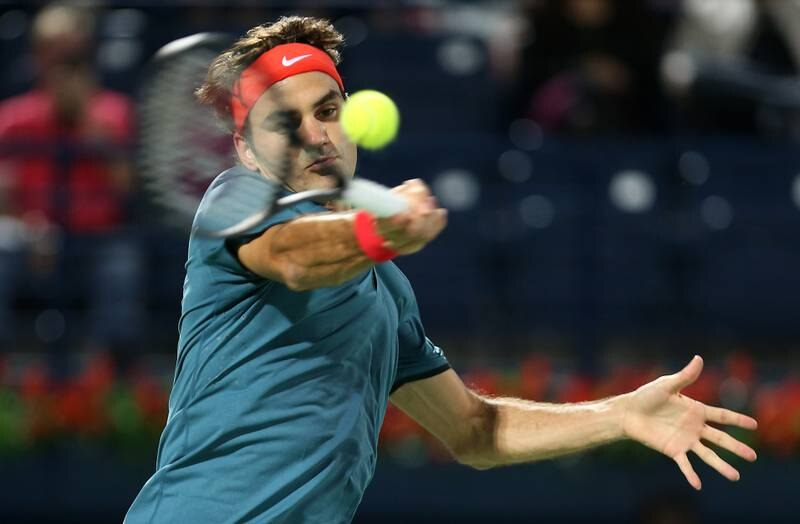 DUBAI , UNITED ARAB EMIRATES Ð  Feb 24 , 2014 : Roger Federer ( SUI ) playing against Benjamin Becker ( GER ) during the first round match of Dubai Duty Free Tennis Championships at Dubai Duty Free Tennis stadium in Dubai. ( Pawan Singh / The National ) For Sports. Story by Ahmed