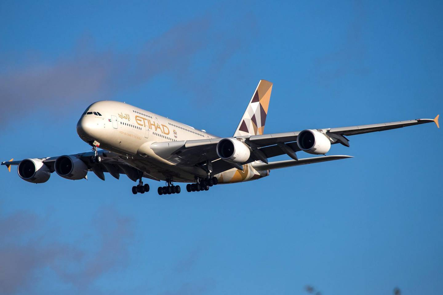 Etihad Airways Airbus A380 with registration A6-APG landing in London Heathrow International Airport in England during a nice day. Etihad or EY is based at Abu Dhabi International Airport in United Arab Emirates and is the flag carrier of UAE. The airline connects daily Abu Dhabi Airport AUH / OMAA to London Heathrow LHR / EGLL. Airbus A380-800 double decker airplane is currently the largest airplane in the world. (Photo by Nicolas Economou/NurPhoto via Getty Images)