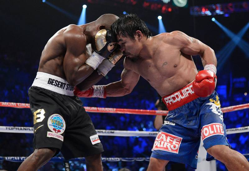 LAS VEGAS, NV - JUNE 09:  (R-L) Manny Pacquiao lands a right to the body of Timothy Bradley during their WBO welterweight title fight at MGM Grand Garden Arena on June 9, 2012 in Las Vegas, Nevada.  (Photo by Kevork Djansezian/Getty Images)
