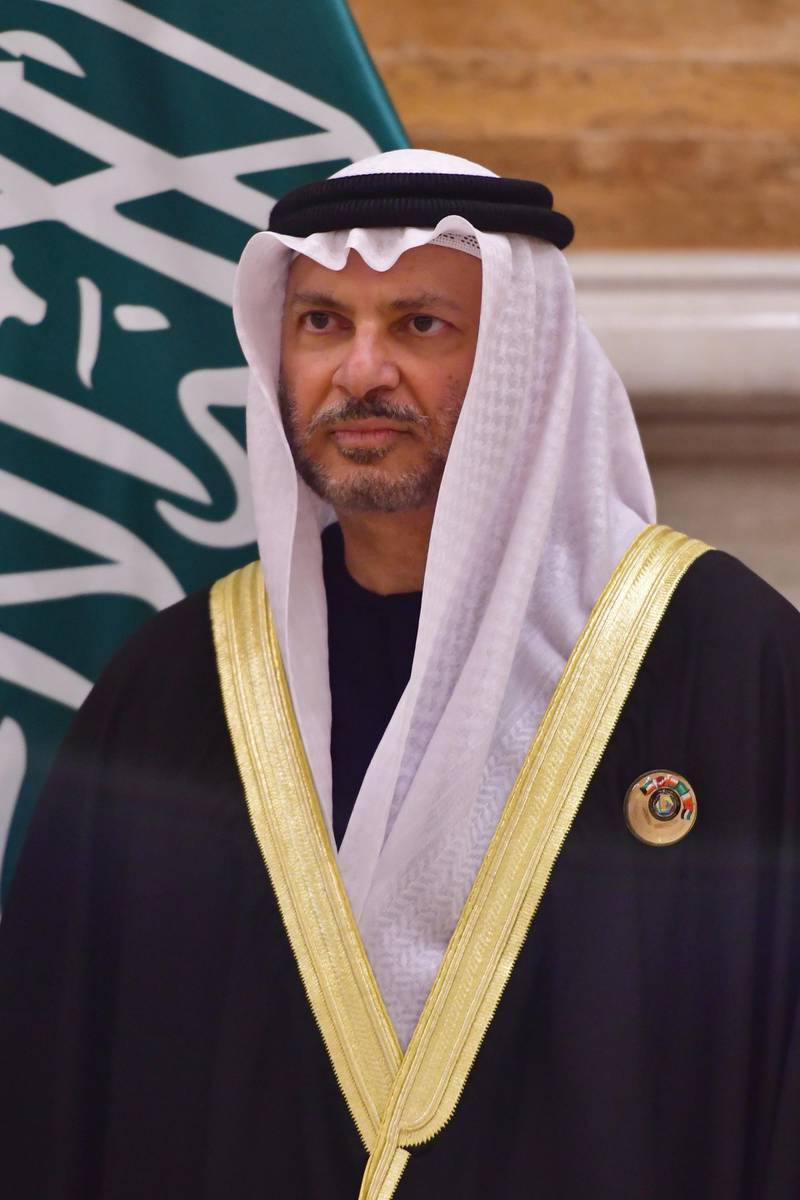 UAE Minister of State for Foreign Affairs Anwar Gargash is seen posing for a family picture at the Gulf Cooperation Council (GCC) at the Bayan palace in Kuwait City on December 5, 2017. The Gulf Cooperation Council, which launches its annual summit today in Kuwait amid its deepest ever internal crisis, comprises six Arab monarchies who sit on a third of the world's oil. A political and economic union, the GCC comprises Saudi Arabia, the United Arab Emirates, Kuwait, Qatar, Oman and Bahrain. Dominated by Riyadh, it is a major regional counterweight to rival Iran.  / AFP PHOTO / GIUSEPPE CACACE