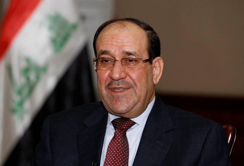 FILE PHOTO - Then Iraqi Prime Minister Nouri al-Maliki speaks during an interview with Reuters in Baghdad in this January 12, 2014. REUTERS/Thaier Al-Sudani/File Photo