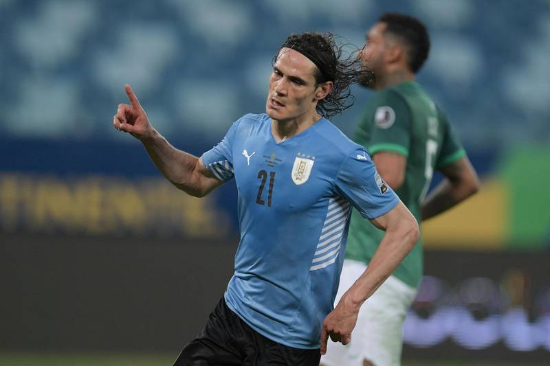 Uruguay's Edinson Cavani celebrates after scoring against Bolivia during their Conmebol Copa America 2021 football tournament group phase match at the Arena Pantanal Stadium in Cuiaba, Brazil, on June 24, 2021. / AFP / DOUGLAS MAGNO