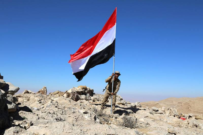 epa06404763 A Yemeni fighter, loyal to the Saudi-backed Yemeni government, holds a Yemeni flag at a position during an offensive against Houthi rebels positions in the Nihem region, east of Sana'a, Yemen, 24 December 2017. According to reports, the Saudi-backed Yemeni forces and tribal fighters have taken strategic regions from Houthi rebels near one of the main entrances to the Yemeni capital Sana'a after more than two and a half years of the conflict in several parts of the war-torn Yemen.  EPA/SOLIMAN ALNOWAB