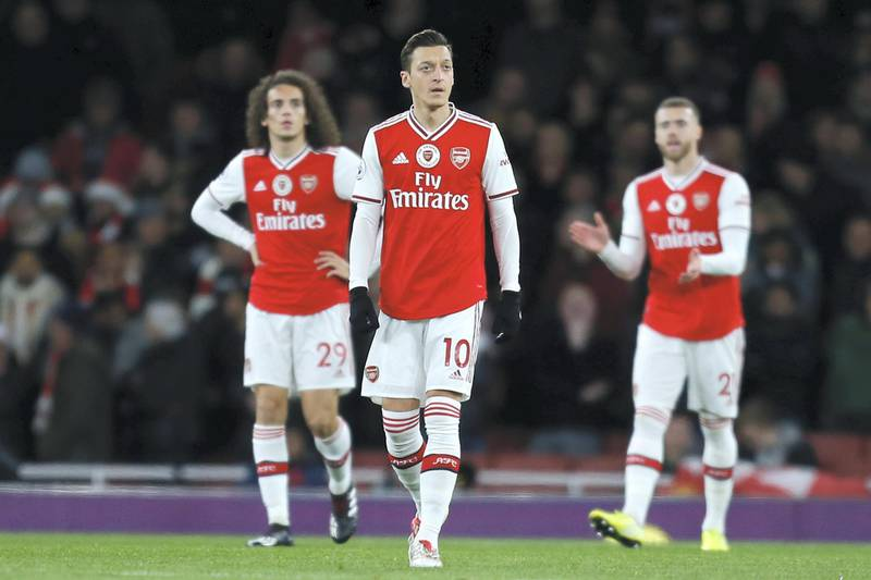 Arsenal's German midfielder Mesut Ozil (C) reacts after going 1-0 behind during the English Premier League football match between Arsenal and Manchester City at the Emirates Stadium in London on December 15, 2019. (Photo by Ian KINGTON / IKIMAGES / AFP) / RESTRICTED TO EDITORIAL USE. No use with unauthorized audio, video, data, fixture lists, club/league logos or 'live' services. Online in-match use limited to 45 images, no video emulation. No use in betting, games or single club/league/player publications.