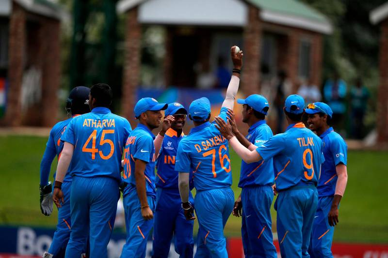 India's Divyaansh Saxena (4th R) celebrates with teammates after he caught out Pakistan's Mohammad Haris off a ball delivered by India's Atharva Ankolekar during the Semi-Final of the ICC Under-19 World Cup between India and Pakistan at the Senwes Park in Potchefstroom on February 4, 2020. / AFP / WIKUS DE WET