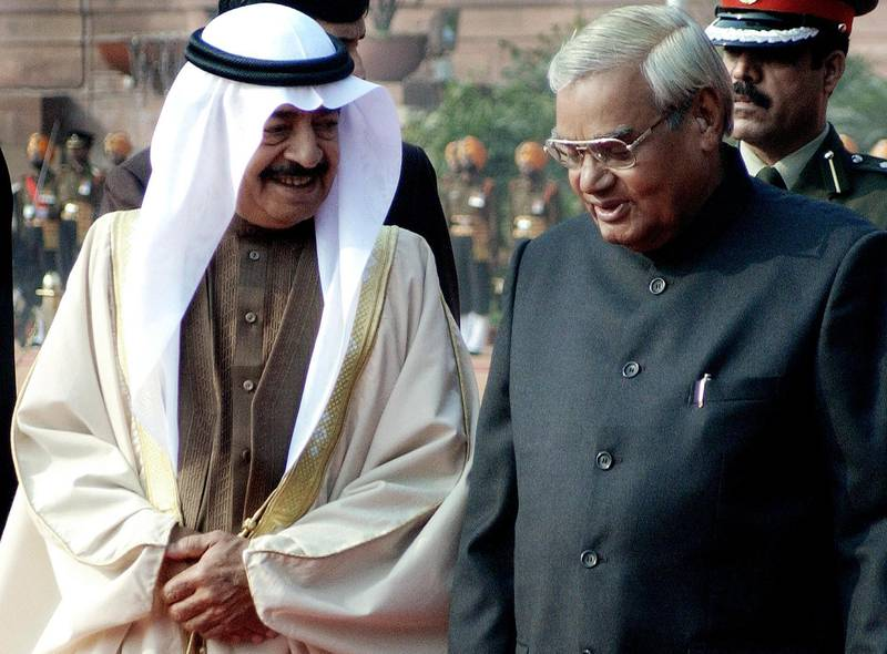 Prime Minister of Bahrain Sheikh Khalifa bin Salman Al-Khalifa (L), speaks with Indian Prime Minister Atal Behari Vajpayee at the Presidential palace in New Delhi, 13 January 2004. Khalifa is on a four-days official visit to India. (Photo by RAVI RAVEENDRAN / AFP)