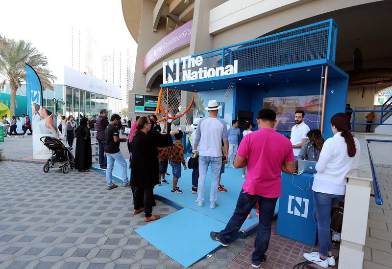 Abu Dhabi, United Arab Emirates - Reporter: Jon Turner: Fans enjoy The Nationals booth during the Mubadala World Tennis Championship. Friday, December 20th, 2019. Zayed Sports City, Abu Dhabi. Chris Whiteoak / The National