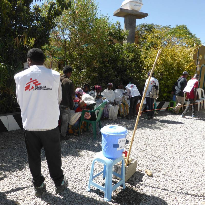 An MSF staff member does crowd control during a mobile clinic in Hawzen, northeast Tigray.