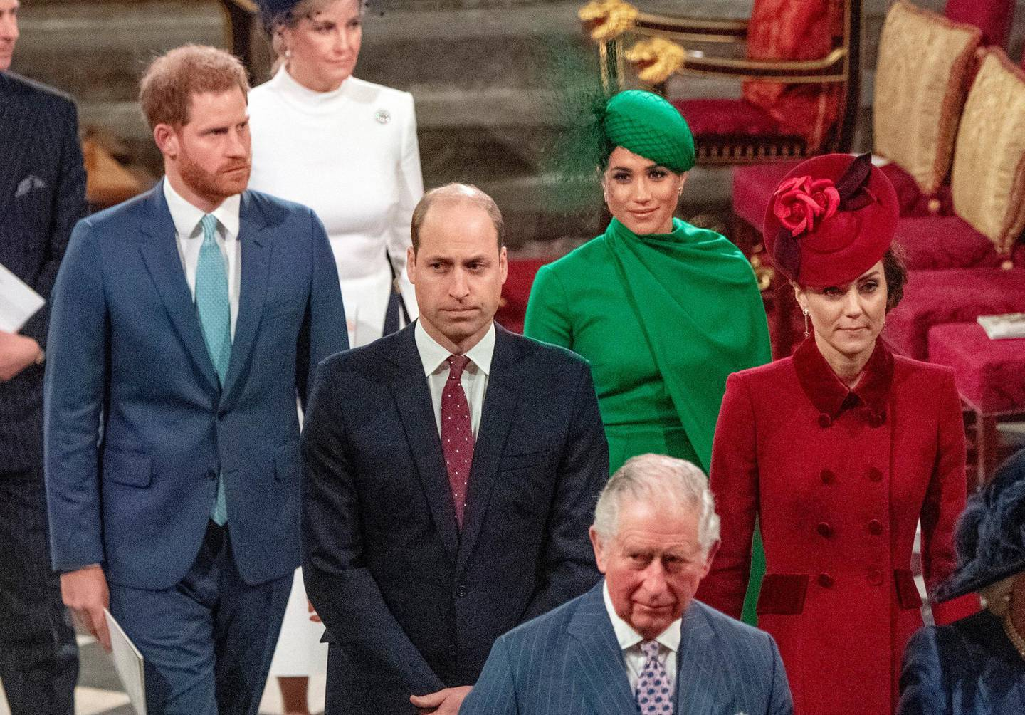 FILE - In this file photo dated Monday March 9, 2020, members of Britain's royal family, with Prince Charles in foreground, followed by Prince William with Kate Duchess of Cambridge, and Prince Harry with Meghan Duchess of Sussex, as they leave the annual Commonwealth Service at Westminster Abbey in London. Britain's Queen Elizabeth II and other members of the royal family along with various government leaders and guests attended the annual Commonwealth Day service, the largest annual inter-faith gathering in the United Kingdom.  The prince's Clarence House office reported on Wednesday, March 25, 2020 that the 71-year-old Prince Charles is showing mild symptoms of COVID-19 and is self-isolating at a royal estate in Scotland, also saying his wife Camilla has tested negative. (Phil Harris / FILE via AP)