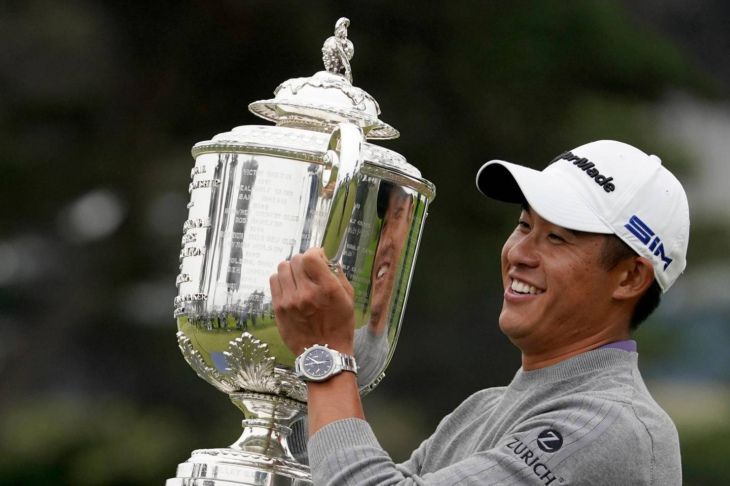 FILE - Collin Morikawa holds the Wanamaker Trophy after winning the PGA Championship golf tournament at TPC Harding Park in San Francisco, in this Sunday, Aug. 9, 2020, file photo. Morikawa was an example of another youth movement when he won his first major at age 23. (AP Photo/Charlie Riedel, File)
