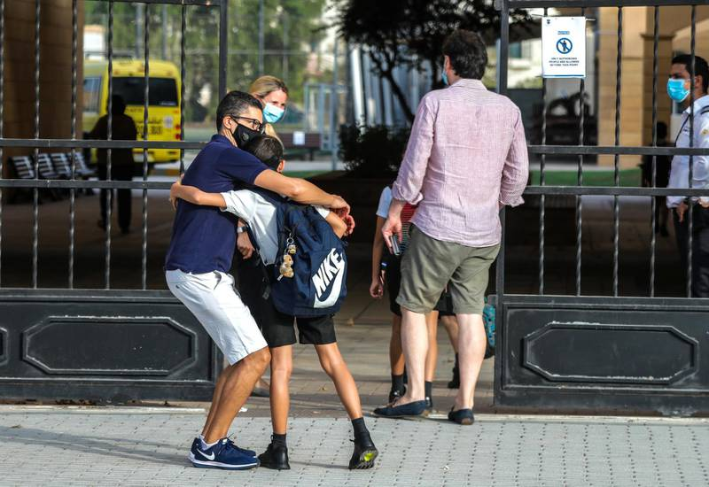 Abu Dhabi, United Arab Emirates, August 30, 2020.  Children return to school on Sunday after months off due to the Covid-19 pandemic at the Brighton College, Abu Dhabi.-  A father and son hug before going back to school.Victor Besa /The NationalSection:  NAReporter:  Haneen Dajani