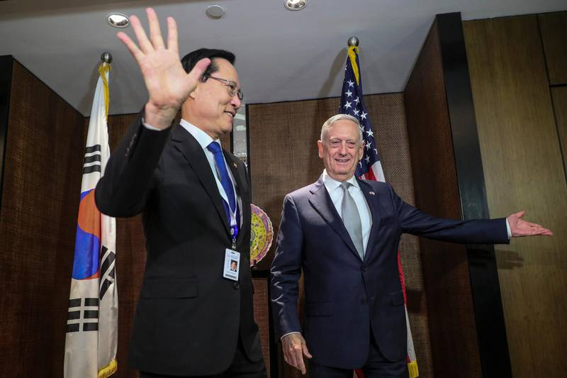 epa06779554 South Korean National Defense Minister Song Young-moo (L) and US Secretary of Defense James Mattis (R) arrive for a bilateral meeting at the sidelines of the International Institute for Strategic Studies (IISS) 17th Asia Security Summit in Singapore, 02 June 2018. The IISS Asia Security Summit is an annual gathering of defense officials in the Asia-Pacific region and is dubbed the Shangri-La Dialogue in honor of the hotel where the event is held. The summit will be held from 01 to 03 June 2018.  EPA/WALLACE WOON